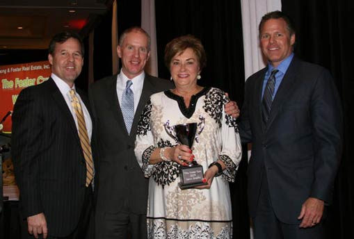 Dawn Bradley receives the Foster Cup award for excellence in real estate.