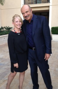 Ida M. Petkus poses for a picture with Dr. Phil McGraw of the Dr. Phil show at the 2014 Domestic Violence Summit. Petkus received the first-place Good Neighbor Award from NJ Realtors for her work to support victims of domestic violence.