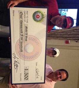 Boomer Foster of Long & Foster Real Estate and Dave Rotell of Prosperity Home Mortgage present Russ Fontaine (center) of Make-A-Wish Mid-Atlantic with a donation. The check was printed in advance with an expectation of a $1,500 donation, but the charity tournament ended up raising over double that amount for Make-A-Wish.