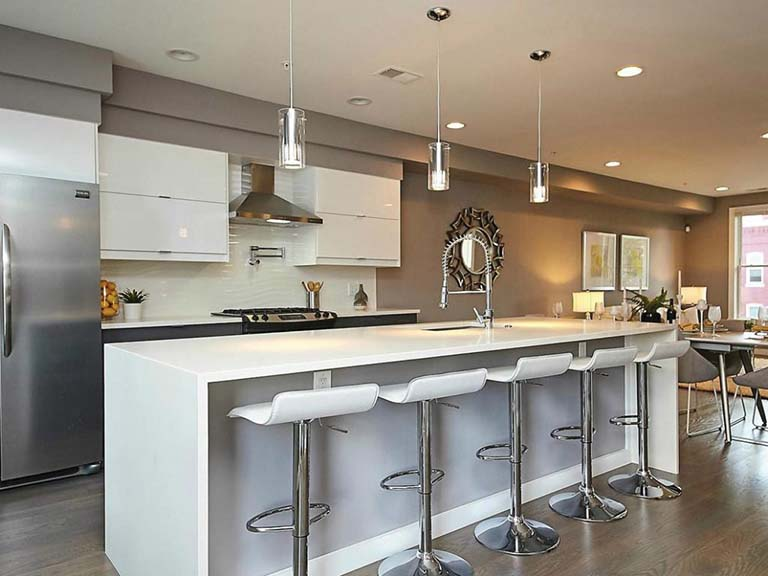 Listed with John Mentis, this Washington, D.C., condo features white quartz countertops.