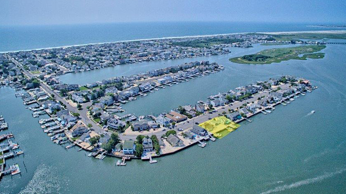 Located on what is considered the best street in Stone Harbor, this double waterfront bay lot featured two older homes, which are being replaced by a magnificent three-level estate that's currently under construction.