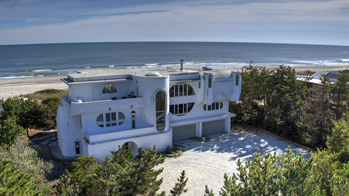 The modern, nautical architectural theme of this home can be seen in its many unique features including rounded windows, doorways and a circular staircase. Situated on two acres of beach front property, this three-story oceanfront estate with 8,000 square feet of living area was Long & Foster's most expensive property sold in 2017.