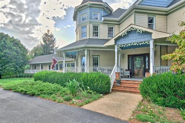 Nestled in the Blue Ridge Mountains, this Victorian-style home is built with fine craftsmanship including centuries-old walnut tongue and groove wainscoting, intricate trim and a handcrafted staircase. Its stately, two-story dining room has a unique dome ceiling and two-story windows to take in the spectacular views.