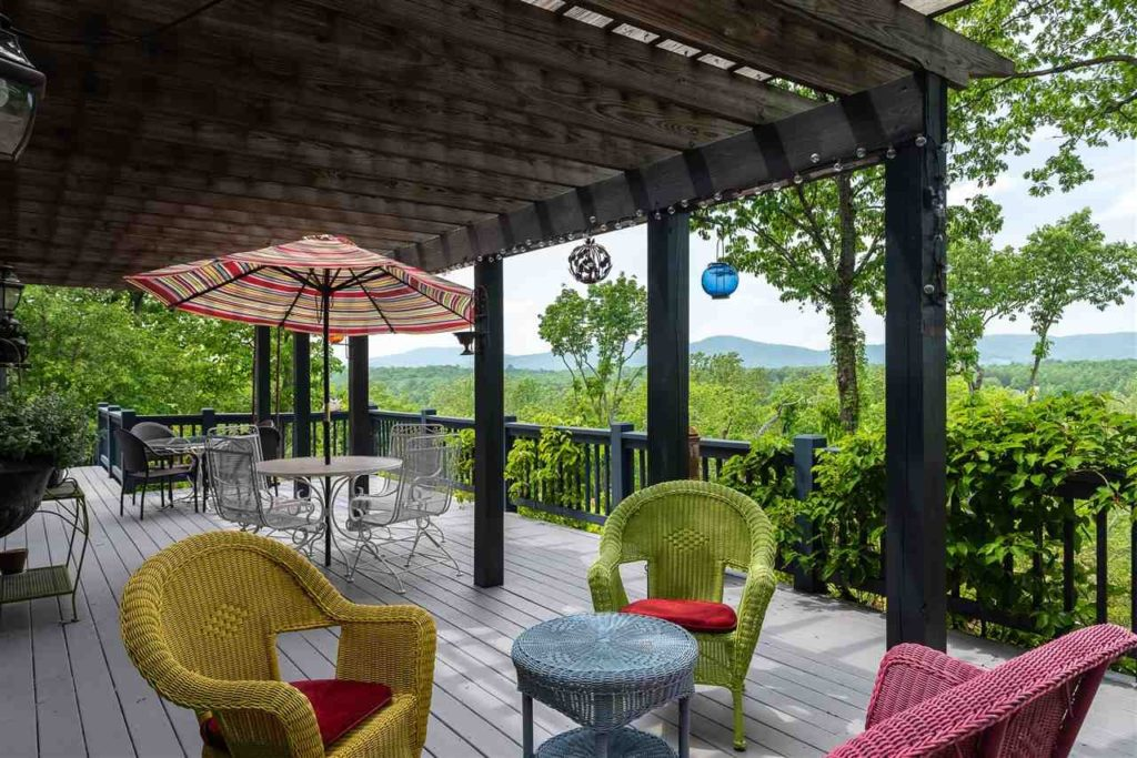 Situated on a 75-acre bluff, this over 3,300 square foot home commands gorgeous mountain views from its porch and floor-to-ceiling windows throughout the home. The property includes a two-acre fenced horse pasture, with shed, hay barn and tack area surrounded by mature gardens.
