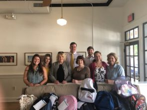 Members of the Strawberry Street office participate in the bookbag drive
